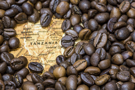 producers: Vintage map of Tanzania covered by a background of roasted coffee beans. This nation is one of the main producers and exporters of coffee. Horizontal image.