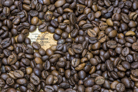 Vintage map of Ecuador covered by a background of roasted coffee beans. This nation is one of the main producers and exporters of coffee. Horizontal image.