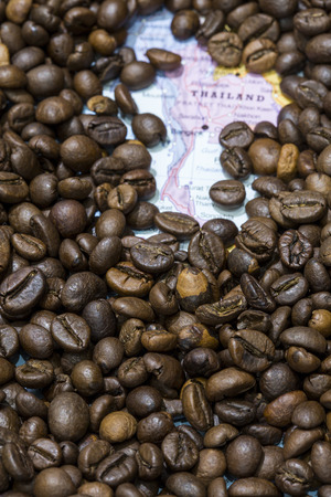 coffea: Geographical map of Thailand covered by a background of roasted coffee beans. This nation is one of the main producers and exporters of coffee. Vertical image. Stock Photo