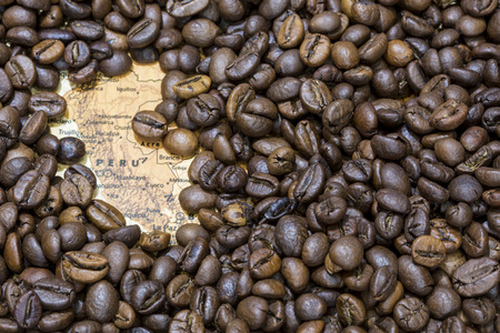producers: Vintage map of Peru covered by a background of roasted coffee beans. This nation is between the ten main producers and exporters of coffee. Horizontal image.