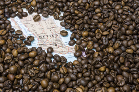 geographical: Geographical map of Mexico covered by a background of roasted coffee beans. This nation is between the ten main producers and exporters of coffee. Horizontal image. Stock Photo