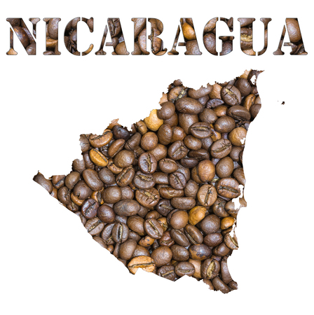 geographical: Roasted brown coffee beans background with the shape of the word Nicaragua and the country geographical map outline. Image isolated on a white background.