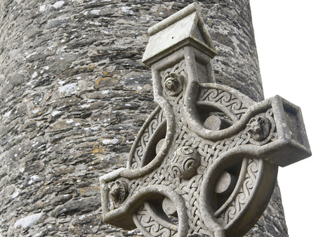 A old stone celtic cross in an irish graveyard, this cross is a traditional religious symbol in Ireland