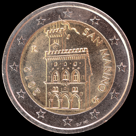 obverse: National side of two euro coin issued by San Marino isolated on a black background. The sammarinese obverse face depicts the Government building