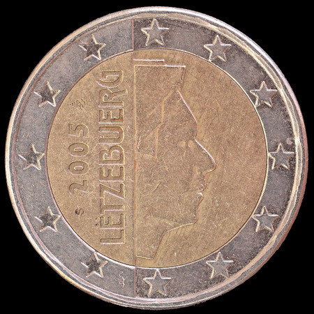 obverse: National side of two euro coin issued by Luxembourg isolated on a black background. The luxembourger obverse face depicts the profile of Royal Highness Grand Duke Henri