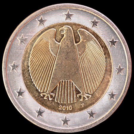 an obverse: National side of two euro coin issued by Germany isolated on a black background. The german obverse face depicts the eagle, the traditional symbol of German sovereignty