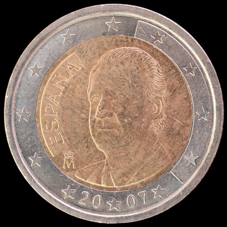 obverse: National side of two euro coin issued by Spain isolated on a black background. The spanish obverse face depicts the effigies of King Juan Carlos I Stock Photo
