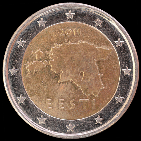 obverse: National side of two euro coin issued by Estonia isolated on a black background. The estonian obverse face depicts a geographical image of Estonia and the word Eesti, which means Estonia