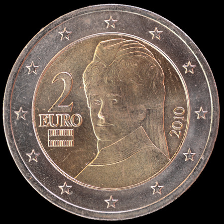 obverse: National side of two euro coin issued by Austria isolated on a black background. The austrian obverse face depicts the support to the peace with a portrait of the pacifist Bertha von Suttner
