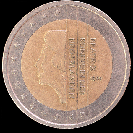 an obverse: National side of two euro coin issued by Netherlands isolated on a black background. The dutch obverse face depicts a portrait of Queen Beatrix