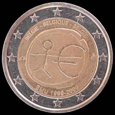 circulated: A commemorative circulated two euro coin issued by Belgium in 2009 celebrating the anniversary of Economic and Monetary Union. Image isolated on black background.