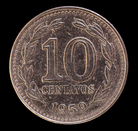 issued: The tail face of 10 centavos coin, issued by Argentina in 1959. Image isolated on black background