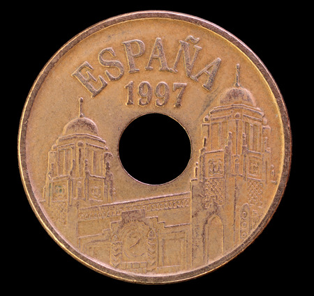 issued: The head face of 25 pesetas coin, issued by Spain in head, obverse, 25, pesetas, spain, depicting towered buildings. Image isolated on black background Stock Photo