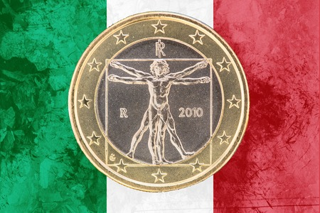 circulated: National side of one euro coin from Italy isolated on the italian flag as background