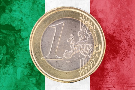 circulated: Common face of one euro coin from Italy isolated on the national italian flag as background