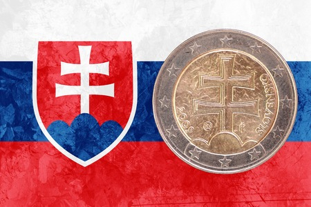 circulated: Two euros coin from Slovakia isolated on the national slovak flag as background Stock Photo