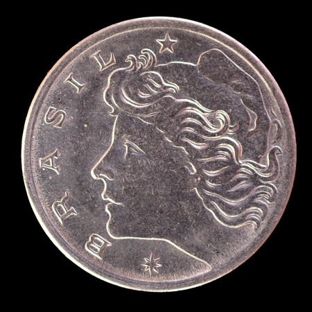 issued: The head face of 5 centavos coin, issued by Brazil in 1969, depicting the effigy of the Liberty. Image isolated on black background Stock Photo