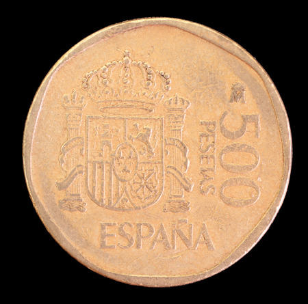 issued: The tail face of 500 pesetas coin, issued by Spain in 1989. Image isolated on black background