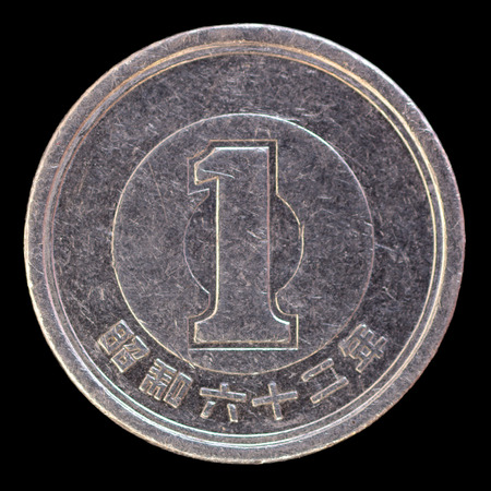 issued: One modern yen coin issued by Japanin the Heisei era. Image isolated on black background