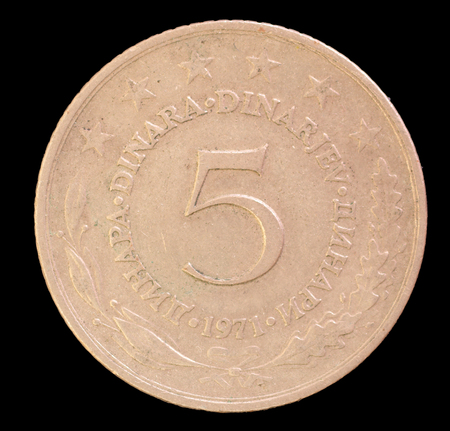 issued: The tail face of 5 dinar coin, issued by Yugoslavia in 1971. Image isolated on black background
