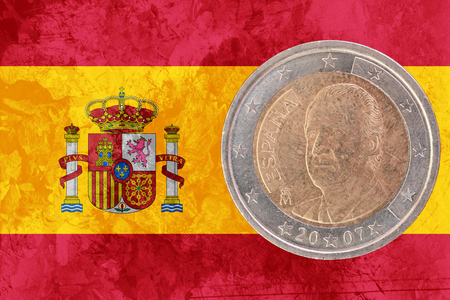 circulated: Two euros coin from Spain isolated on the national spanish flag as background