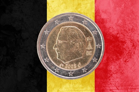 head: Two euros coin from Belgium isolated on the national belgian flag as background Stock Photo