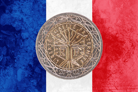 circulated: Two euros coin from France isolated on the national french flag as background Stock Photo