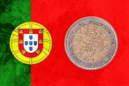 circulated: Two euros coin from Portugal isolated on the national portuguese flag as background