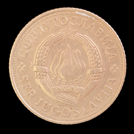 yugoslavia federal republic: The head face of 5 dinar coin, issued by Yugoslavia in 1971, depicting the Coat of arms of the Socialist Federal Republic of Yugoslavia. Image isolated on black background