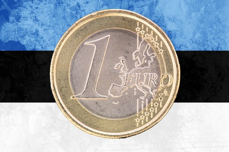 estonian: Common face of one euro coin from Estonia isolated on the national estonian flag as background Stock Photo