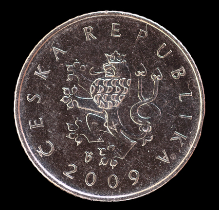 czech republic coin: The head face of one crown coin, issued by Czech Republic in 2009, depicting the lion, symbol of the country. Image isolated on black background