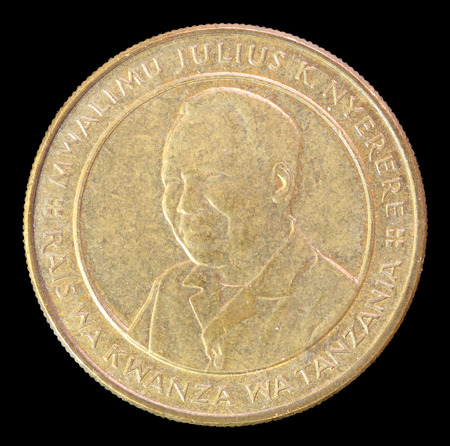 issued: The head face of 100 shillings coin, issued by Tanzania in 2012, depicting the portrait of the first president Julius Nyerere. Image isolated on black background