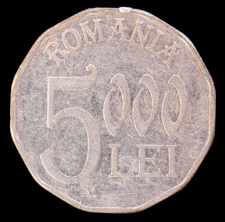 issued: The tail face of 5000 lei coin, issued by Romania in 2002. Image isolated on black background Stock Photo