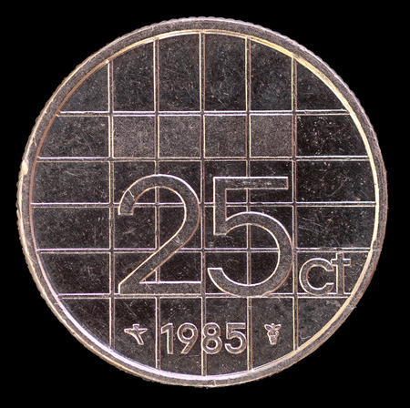 25 cents: The tail face of 25 cents of guilder coin, issued by Netherlands in 1985. Image isolated on black background