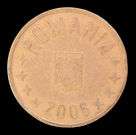 issued: The head face of 50 bani coin, issued by Romania in 2006. Image isolated on black background