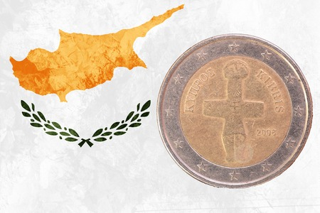 cypriot: Two euros coin from Cyprus isolated on the national cypriot flag as background