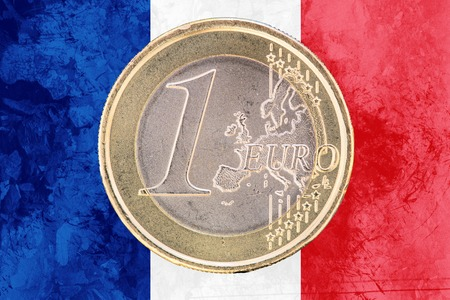 circulated: Common face of one euro coin from France isolated on the national french flag as background