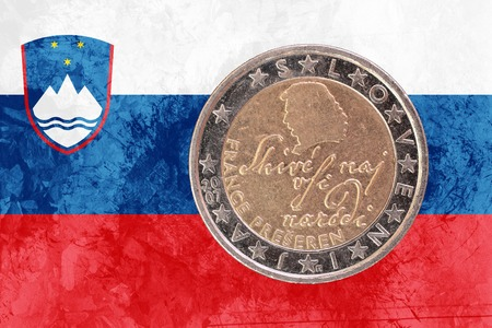 circulated: Two euros coin from Slovenia isolated on the national slovene flag as background