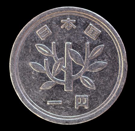issued: One modern yen coin issued by Japan in the Heisei era, depicting a young tree. Image isolated on black background