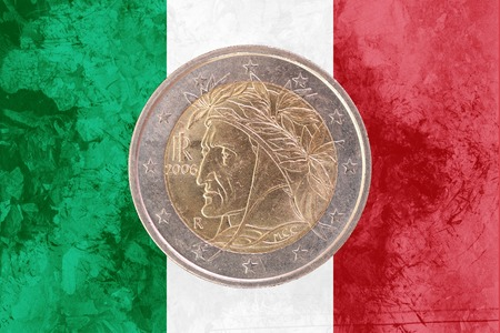 circulated: Two euros coin from Italy isolated on the national italian flag as background