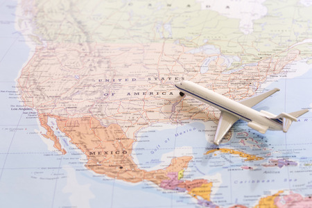 Miniature of a passenger plane flying on the map of United States of America from south east. Conceptual image for tourism and travel