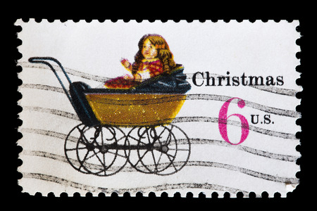 depict: UNITED STATES OF AMERICA - CIRCA 1970: A used postage stamp printed in United States shows a doll carriage to depict Childrens Toys for Christmas, circa 1970