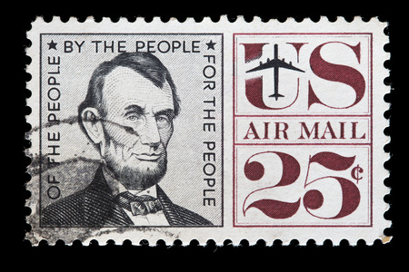 abraham lincoln: UNITED STATES OF AMERICA - CIRCA 1960: A used air mail postage stamp printed in United States shows the President Abraham Lincoln, circa 1960