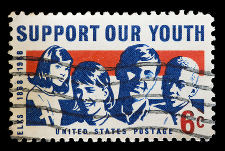 used stamp: UNITED STATES OF AMERICA - CIRCA 1968: A used postage stamp printed in United States shows a group of young boys and girls and the text Support our Youth, circa 1968