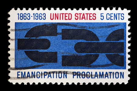 emancipation: UNITED STATES OF AMERICA - CIRCA 1963 : A used postage stamp printed in United States shows a broken chain to commemorate the Anniversary of Emancipation Proclamation, circa 1963