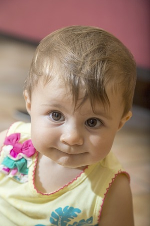 one year old: Close-up of adorable little one year old girl with brown eyes Stock Photo