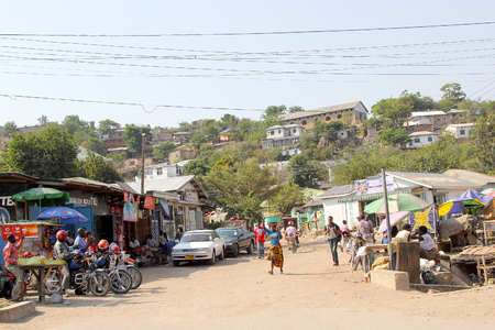 mwanza: MWANZA, TANZANIA - JUNE 11: people in a small market along one of the main road of the town on June 11, 2013 in Mwanza