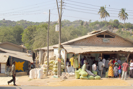 mwanza: MWANZA, TANZANIA - JUNE 11: people queuing at a local store with bags of maize piled outside on June 11, 2013 in Mwanza Editorial