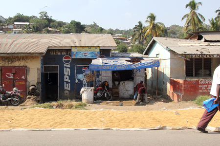 MWANZA, TANZANIA - JUNE 11: local stores with maize put out in the sun to dry along the road on June 11, 2013 in Mwanza