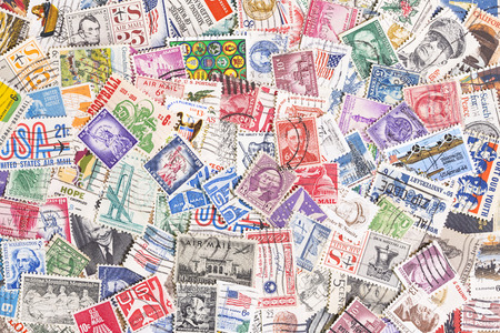 postage stamps: Background of many used postage stamps from United States